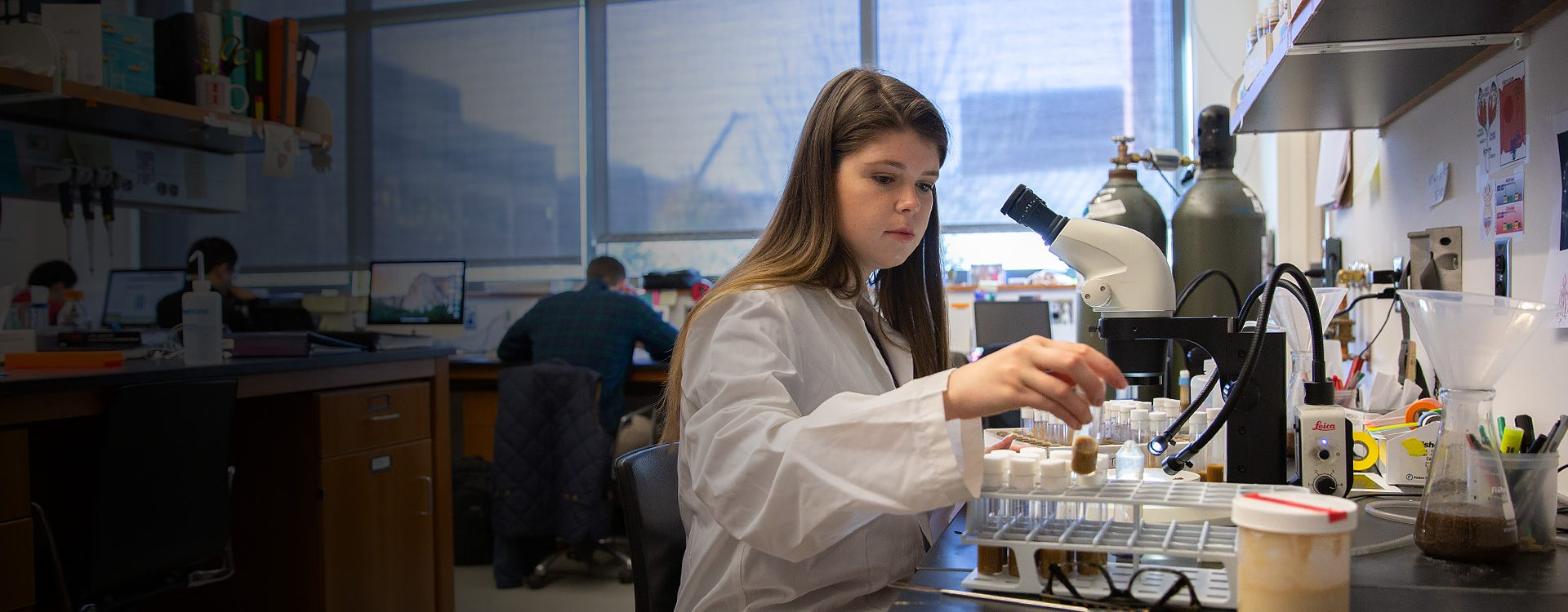 A student analyzes samples in a research lab